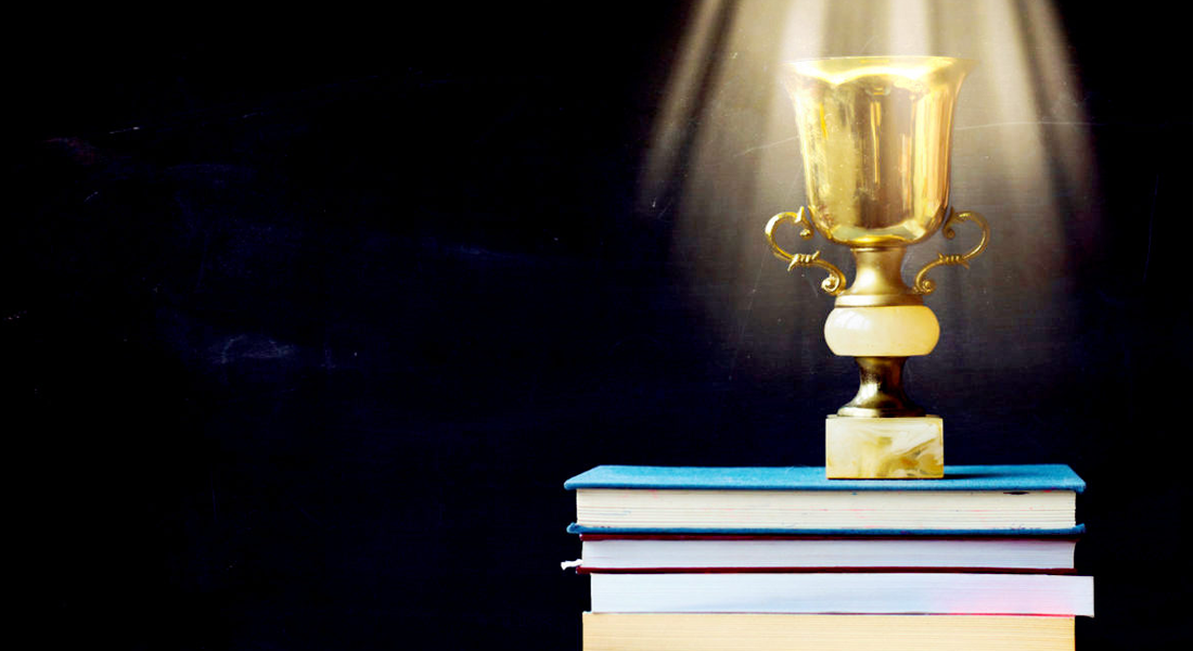 Award on top of books