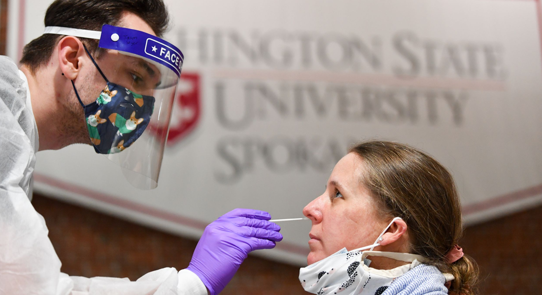 covid nasal swap being administered