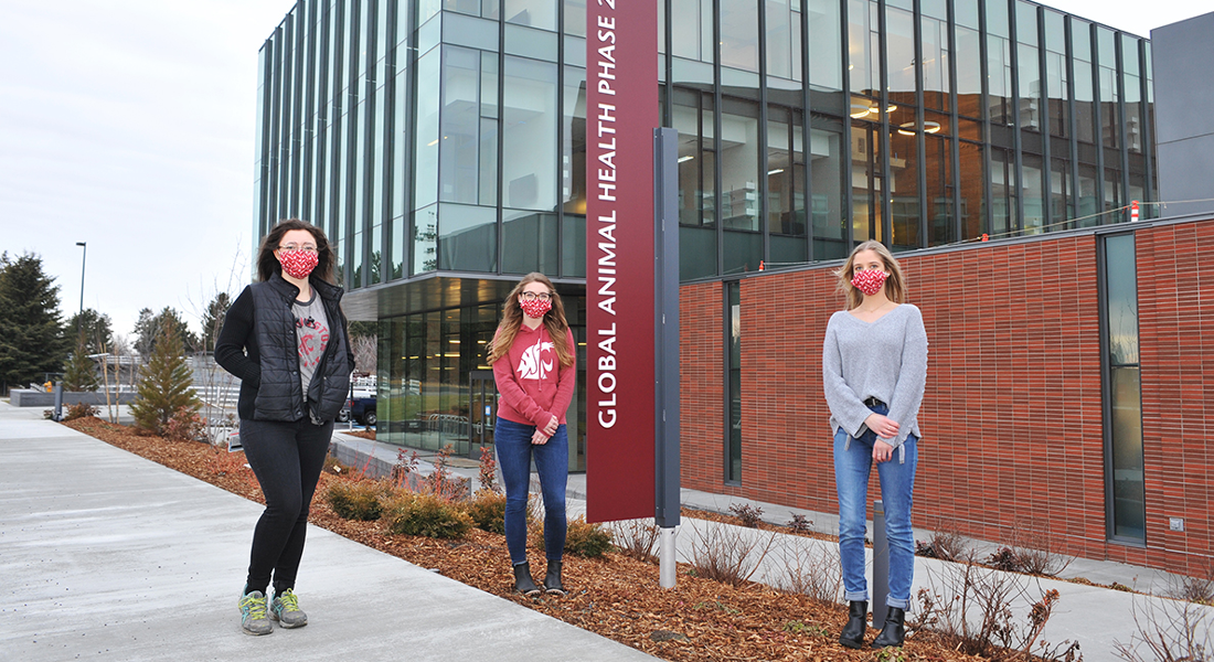 Microbiologists Sylena Harper, Hannah Wilson, and Victoria Fitzpatrick, all recent 2020 WSU graduates, pose outside the soon-to-be-opened Global Animal Health Phase 2 building.